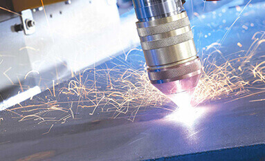 A burst of sparks being discharged from a laser and plasma cutting tool in process.