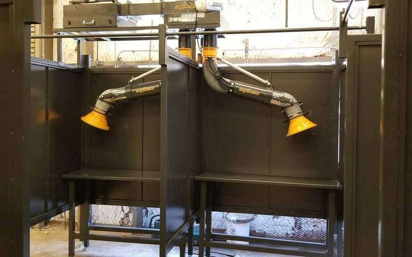 Welding booths with fume arms